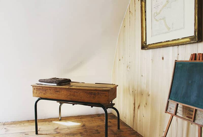 Former school desk in the Loft | La Colonie Aubrac